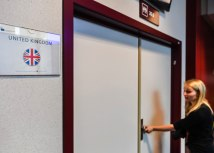 A journalist tries to open the locked door of the British briefing room during an EU summit in Brussels on June 29 (Tanjug/AP)