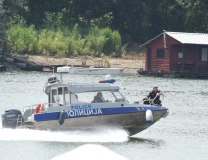 A police boat is seen near Ada Medjica on Thursday (Tanjug)