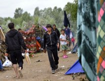 Migrants are seen on the Serbian side of the Hungarian-Serbian border near Horgos, on July 16 (Tanjug/AP)