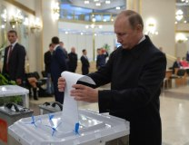 Vladimir Putin votes at a polling station in Moscow (Tanjug/AP)