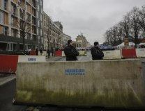 Armed police stand behind concrete blocks near the Brandenburg Gate in Berlin on Dec. 23 (Tanjug/AP)
