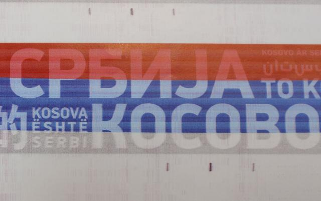 The colors of the Serbian flag with the inscription 'Kosovo is Serbia' are attached to the train's exterior (Tanjug)