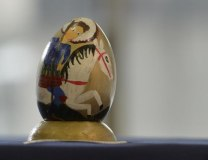 An Easter egg painted by children, depicting St. George slaying the dragon (Tanjug, file)