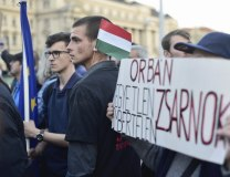 The message 'Orban is a cruel, inhuman tyrant' is displayed during protests against 'anti-Soros law' (Tanjug/AP, file)