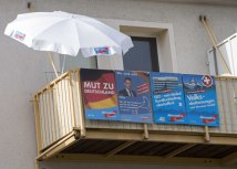 AfD posters are seen on a balcony in Hoyerswerda (Tanjug/AP, file)