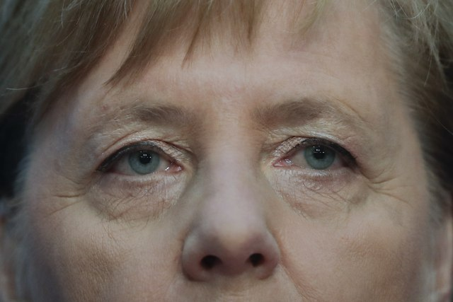Merkel to step down as party leader with authority hit by losses