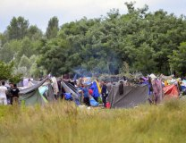 Migrant tents are seen in a camp on the Serbian side of the Hungarian-Serbian border near Horgos, on July 16 (Tanjug/AP)