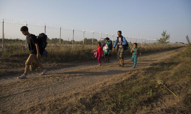 A Sept. 2, 2015 file photo of a migrant family from Afghanistan after crossing from Serbia to Asotthalom, Hungary (Tanjug/AP)