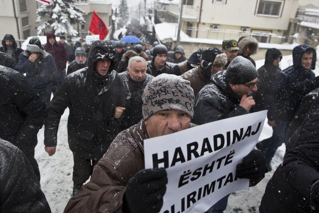 A protester in Pristina holds a sign reading, 'Haradinaj is a liberator' (Tanjug)