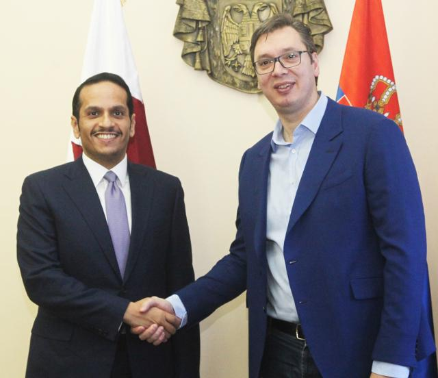 Al Thani, left is seen with Aleksandar Vucic in Belgrade on Monday (Tanjug)