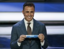 Fabio Cannavaro holds up the team name of Serbia (Tanjug/AP)