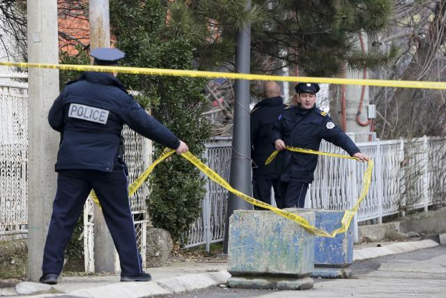 Kosovo police are seen near the scene of the crime on Tuesday (Tanjug/AP)