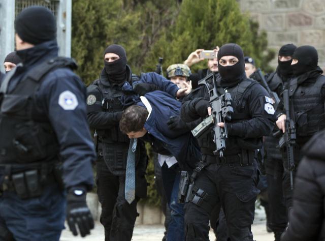 Djuric is seen in Kosovo police custody in the streets of Pristina on Monday (Tanjug/AP)