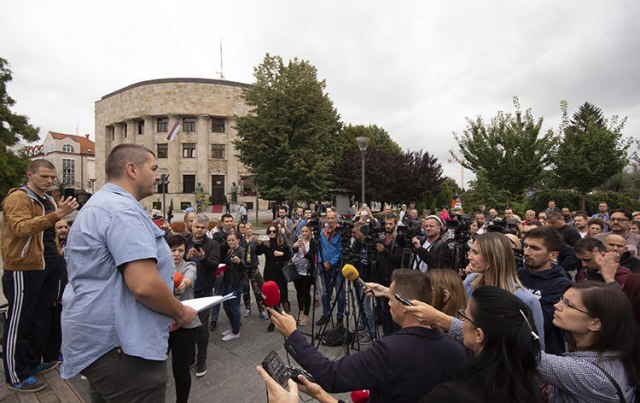Bosnian journalists gather in Banja Luka to protest against an attack on Kovacevic (AP Photo)