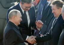Miller (R) is seen in Belgrade on Thursday with presidents Putin and Vucic