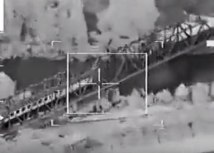 A NATO warplane targetting a train on a bridge in Serbia during the 1999 attack (screenshot, file)