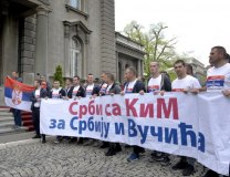 The banner reads, 'Serbs from KiM, for Serbia and Vucic' (Tanjug)