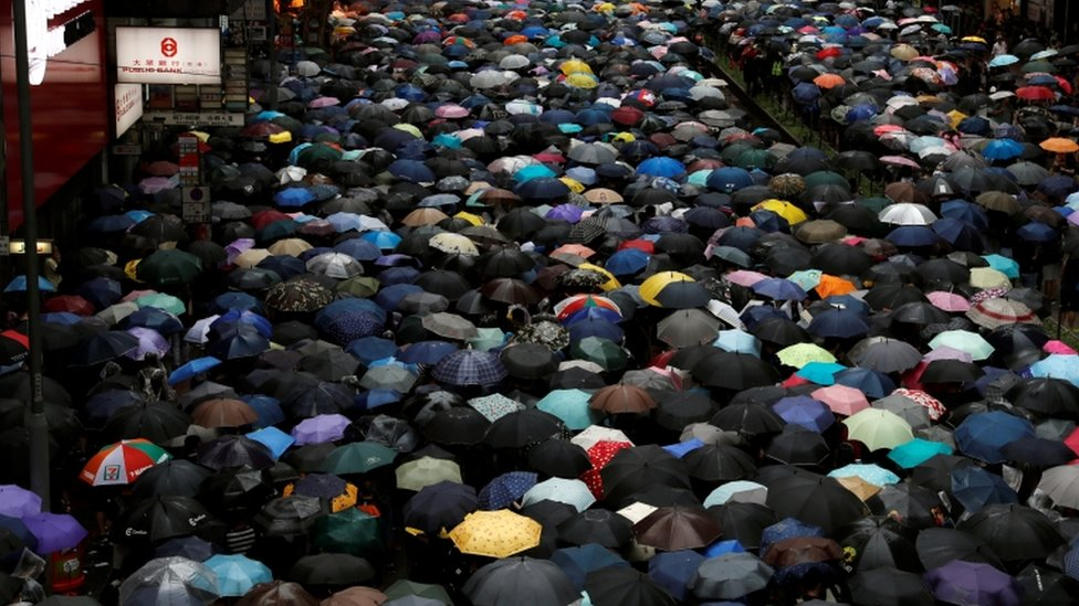 Protesters have been marching in heavy rain/Reuters