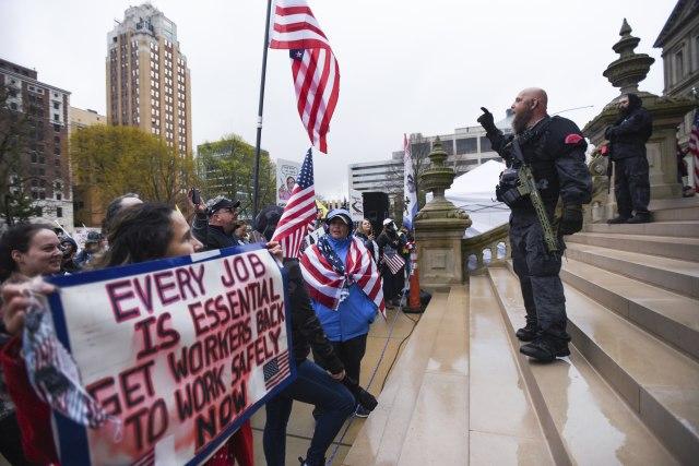 Matthew Dae Smith/Lansing State Journal via AP